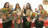 Winners of our Baby of the Year contest receive their prizes from Miss Gibraltar